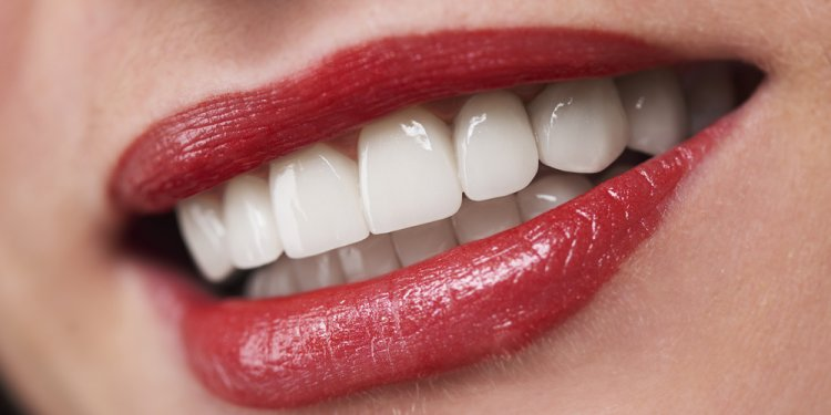 Dental Implants or Dentures: